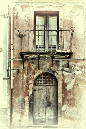 unsightly: Unsightly Facade of the Old House in Sicilian City of Piazza Armerina, Retro Image Filtered Style
