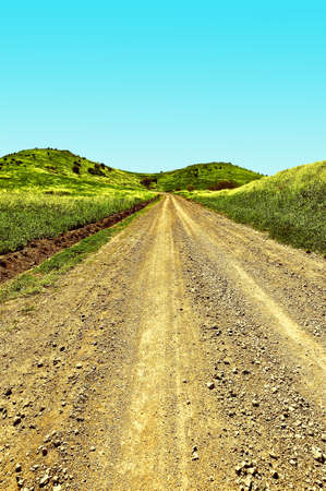 golan: Dirt Road in the Golan Heights, Early Spring in Israel, Vintage Style Toned Picture Stock Photo