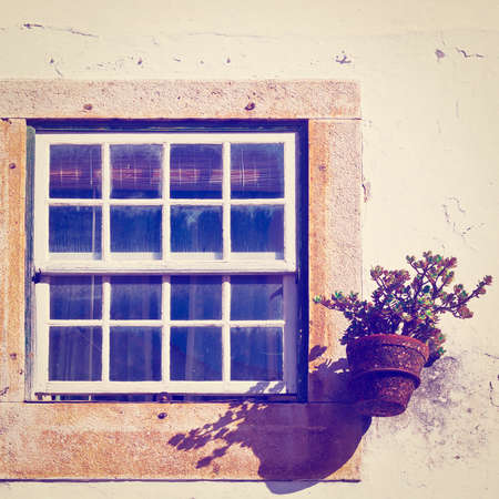 resplendence: Window of Portuguese Home Decorated with Flower Stock Photo