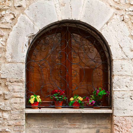 resplendence: Arched Window Decorated With Fresh Flowers in Italy