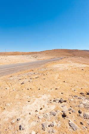 desert road: Winding Asphalt Road in the Negev Desert in Israel