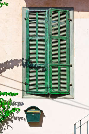 resplendence: Israel Window with Closed Wooden Shutters in Tel Aviv