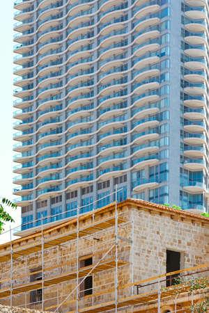 resplendence: Old Houses under Reconstruction in Tel Aviv on the Background of the Modern Building