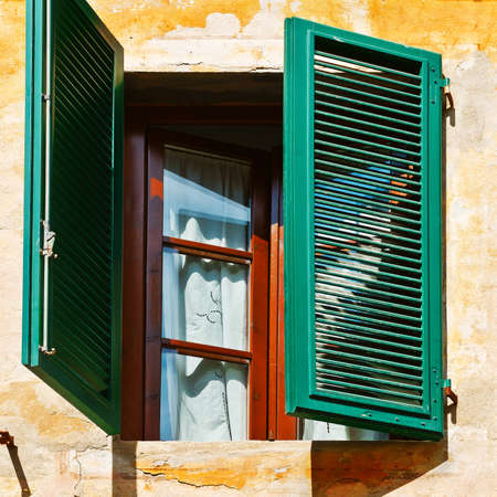 resplendence: Italian Window with Open Wooden Shutters Stock Photo