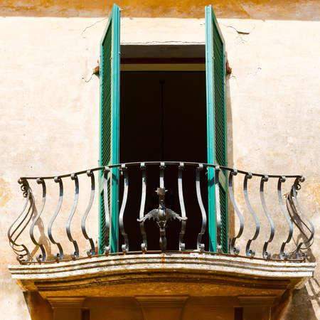 resplendence: Italian Balcony with Open Wooden Shutters Stock Photo