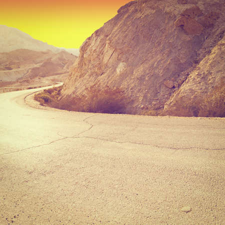 judean hills: Meandering Road in Sand Hills of Judean Mountains at Sunset, Instagram Effect