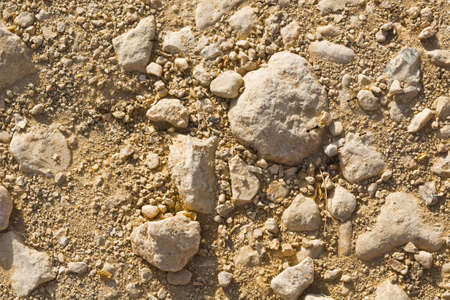 riverbed: Stones and Sand of Desert as the Natural Background
