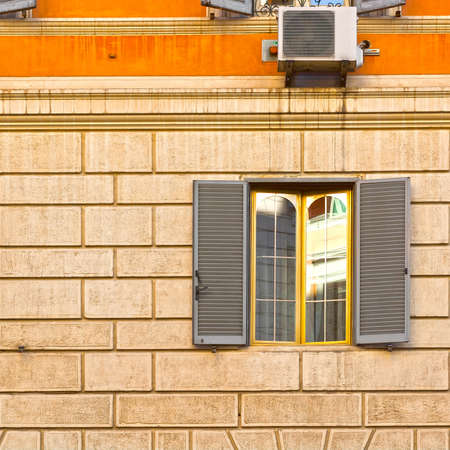 resplendence: Facade of an Old Roman House with Window and Modern Conditioner Stock Photo