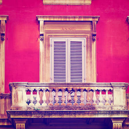 resplendence: Facade of the Old Italian House with Balcony in Rome, Instagram Effect Stock Photo