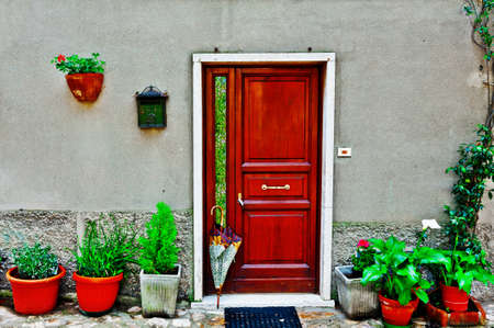 Facade of Italian House Decorated with Fresh Flower Stock Photo