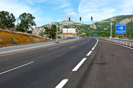 toll: Traffic Lights on the Toll Road Before Entering the Tunnel in Spain Stock Photo