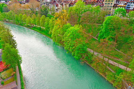 river view: Aerial View to the Roofs of the City of Berne and River Aare in Switzerland Stock Photo
