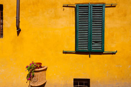 resplendence: Closed Window of Old Building in Italy