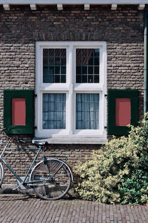 red shutters: Window with Red Shutters in the Dutch City, Vintage Style Toned Picture