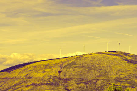 energy picture: Modern Wind Turbines Producing Energy in Portugal, Vintage Style Toned Picture Stock Photo