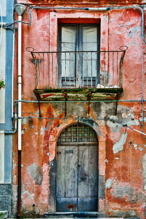 unsightly: Unsightly Facade of the Old House in Sicilian City of Piazza Armerina Stock Photo