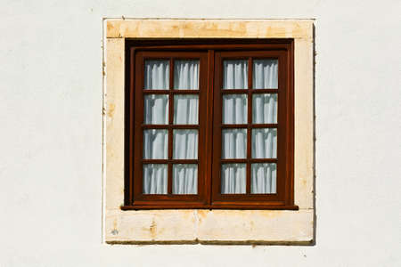 resplendence: Window in the Wall of Portuguese Home Stock Photo