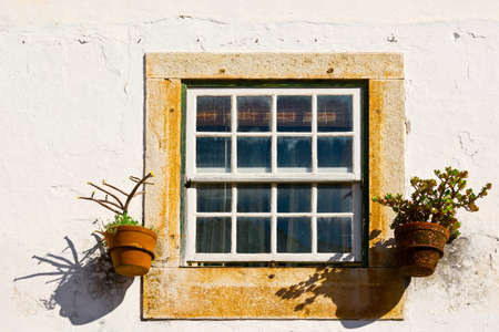 Window of Portuguese Home Decorated with Flower Stock Photo