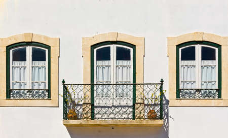 resplendence: Portuguese Windows with a Balcony
