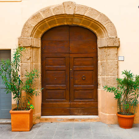 Wooden Ancient Italian Door in Historic Center Stock Photo