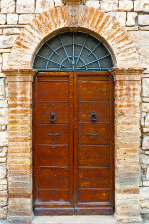 clincher: Wooden Ancient Italian Door in Historic Center Stock Photo
