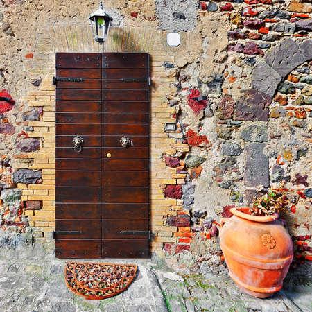 Wooden Ancient Italian Door in Historic Center Stock Photo