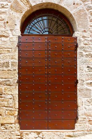 peg board: Wooden Ancient Italian Door in Historic Center Stock Photo