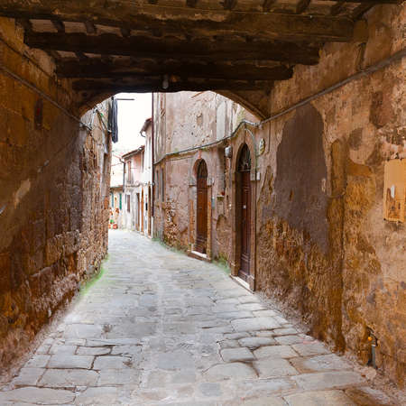 Narrow Alley with Arch in Italian City of Sorano