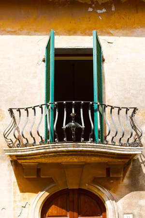 resplendence: Italian Balcony with Open Wooden Shutters Stock Photo