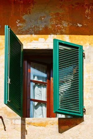 resplendence: Italian Window with Open Wooden Shutters Stock Photo