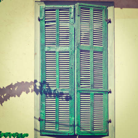Israel Window with Closed Wooden Shutters in Tel Aviv, Instagram Effect