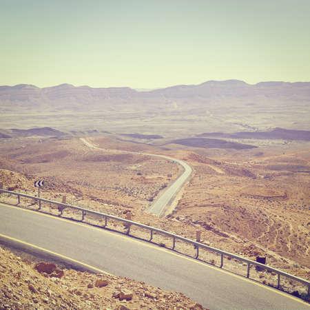 nature reserves of israel: Winding Asphalt Road in the Negev Desert in Israel