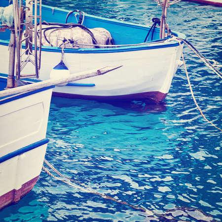 trawl: Trawl Winch on the Deck of Fishing Boat in the Port of Italian City of Cetara Stock Photo