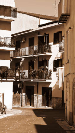 resplendence: Italian Balconies Decorated with Fresh Flowers, Vintage Style Sepia