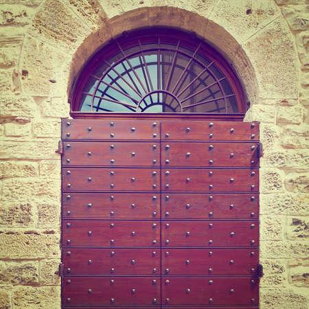 Wooden Ancient Italian Door in Historic Center,