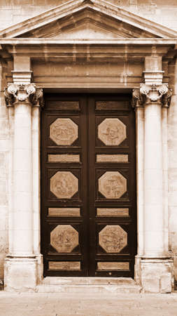 ragusa: Door of the Church Decorated with Scenes from the Life of Bible in the Sicilian City of Ragusa, Vintage Style Sepia