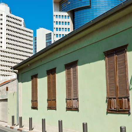 Old Houses after Reconstruction in Tel Aviv on the Background of the Modern Building Stock Photo