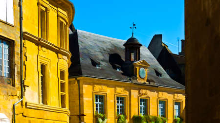 peaked: Black Tiles on the Peaked Roofs in French City of Sarlat, Stylized Photo Stock Photo