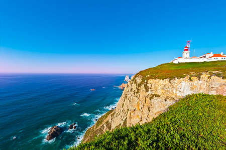 roca: Lighthouse on the Rocky Coast of Atlantic Ocean in Cabo da Roca at Sunset
