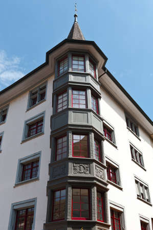 renovated: Renovated Facade of the Old Swiss House with Bay Windows Stock Photo