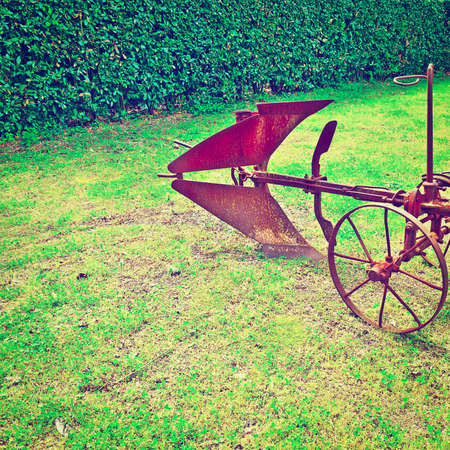 winnower: Old Agricultural Machine on a Green Grass Stock Photo