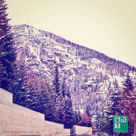 bernard: Saint Bernard Pass on the Background of Snow-capped  Italian Alps Stock Photo
