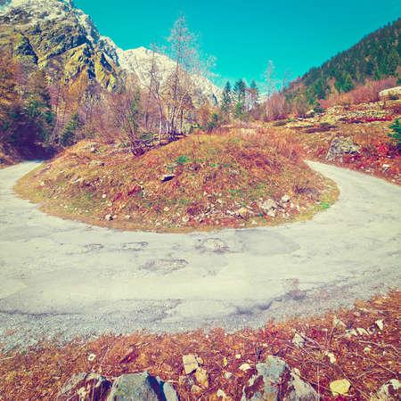 abrupt: Abrupt Bend in the Asphalt Road in the Italian Alps