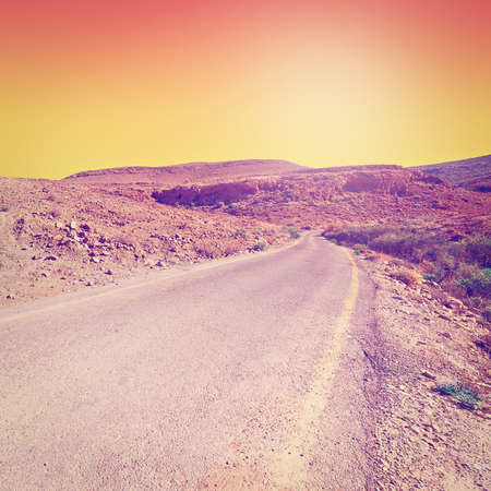 judean hills: Meandering Road in Sand Hills of Judean Mountains at Sunset,