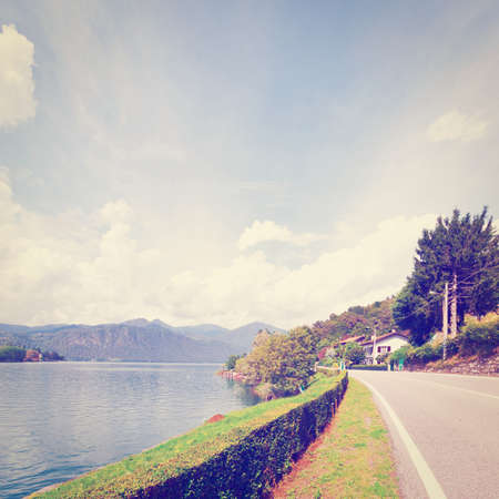 orta: Asphalt Road along the Lake Orta in the Italian Alps,