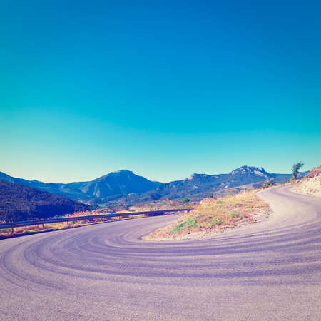 Winding Asphalt Road in the French Alps, Stock Photo