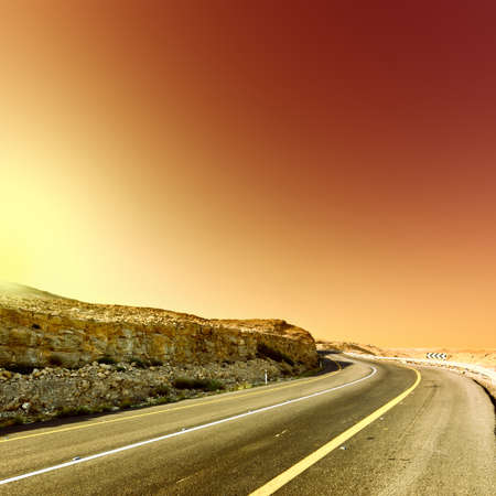 Asphalt Road in the Judean Desert on the West Bank at Sunset, Vintage Style Toned Picture