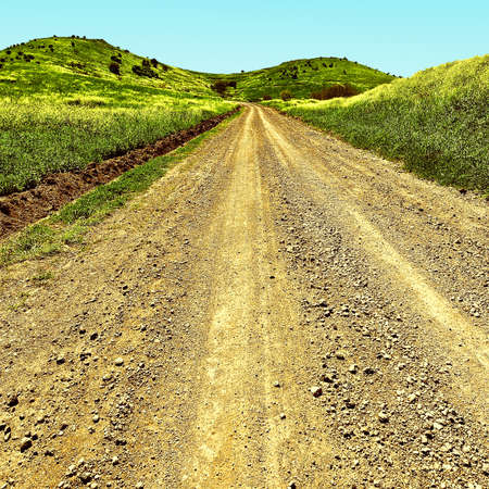 Dirt Road in the Golan Heights, Early Spring in Israel, Vintage Style Toned Picture Stock Photo
