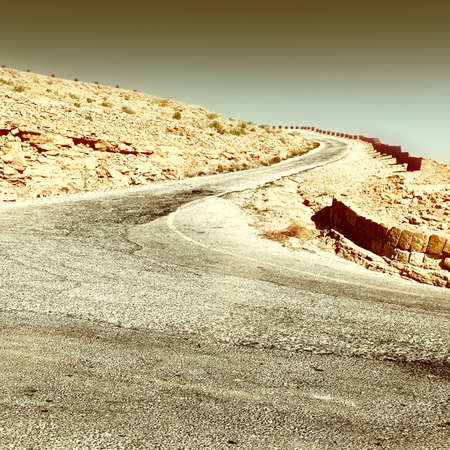Meandering Road in Sand Hills of Judean Mountains, Israel, Retro Image Filtered Style Stock Photo