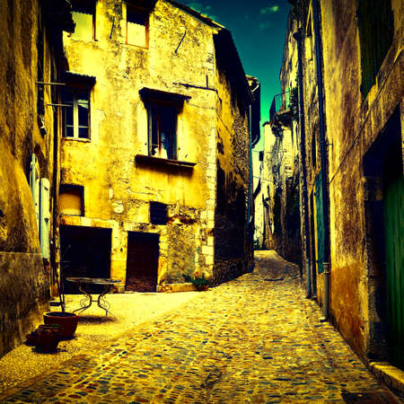 Old Street in the French City of Viviers at Night, Vintage Style Toned Picture Stock Photo